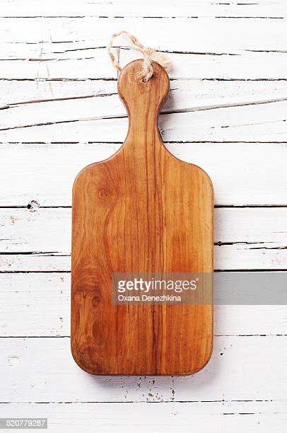 Kitchen board on the wooden table