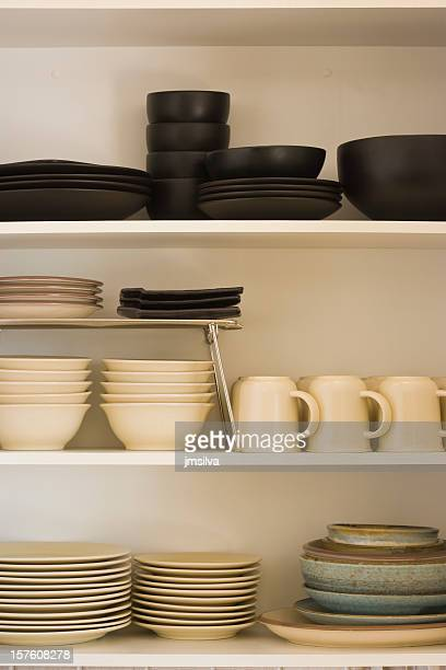 Kitchen cabinet with black and white dishes