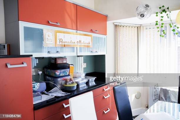 kitchen cabinets with ramadan celebration banner - religion stock pictures, royalty-free photos & images