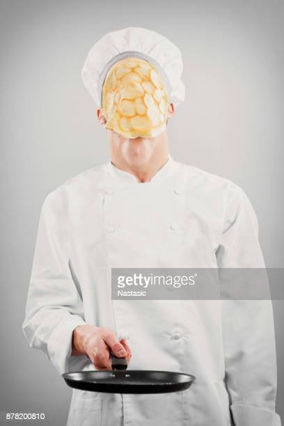 kitchen chef with pancake on face - pancake stock pictures, royalty-free photos & images