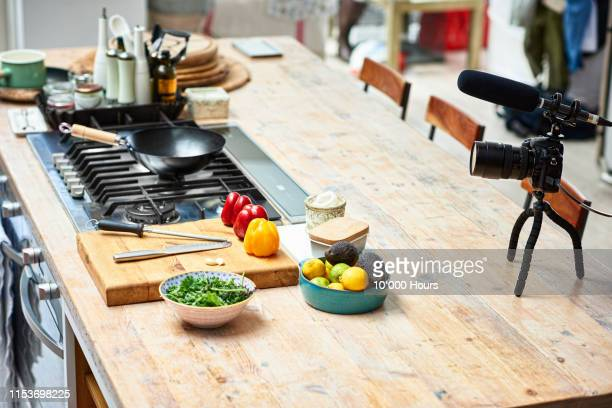 kitchen counter set up with video camera and fresh ingredients - domestic kitchen stock pictures, royalty-free photos & images