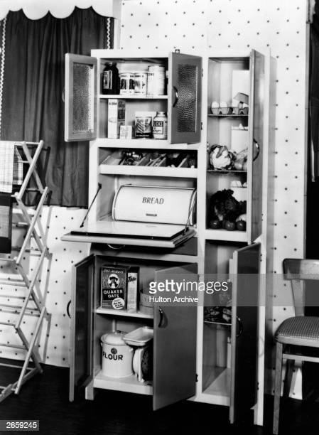 A kitchen cupboard containing Quaker porridge oats Tide washing powder Horlicks All Bran and various fruit and vegetables The staple diet of an...
