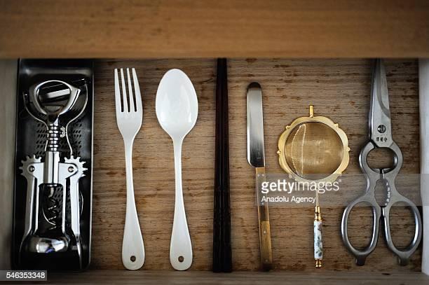 Kitchen equipment are seen in a drawer in the kitchen of minimalist Saeko Kubishiki in Fujisawa Kanagawa Prefecture in the southern of Tokyo Japan on...
