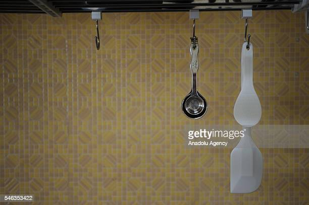 Kitchen equipments are seen hanging in the kitchen of minimalist Katsuya Toyoda in Tokyo Japan on July 02 2016 Katsuya Toyoda an online publication...