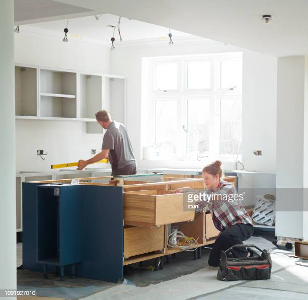 kitchen fitters - home improvement stock pictures, royalty-free photos & images