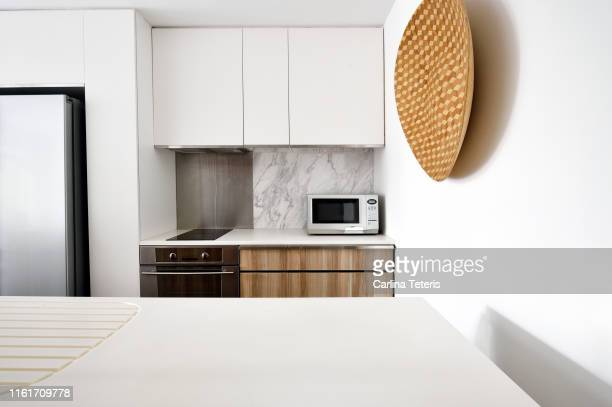 kitchen in a modern luxury condo - kitchen counter stock pictures, royalty-free photos & images