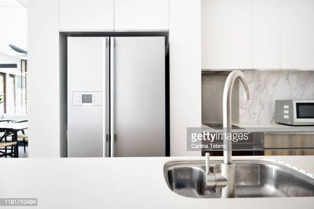 kitchen in a modern luxury condo - empty fridge stock pictures, royalty-free photos & images