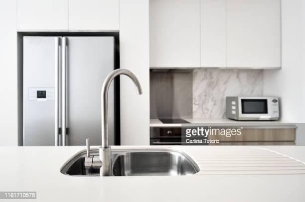 kitchen in a modern luxury condo - ho bildbanksfoton och bilder