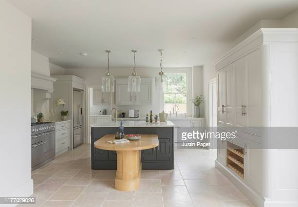 kitchen in new build luxury house - white goods stock pictures, royalty-free photos & images