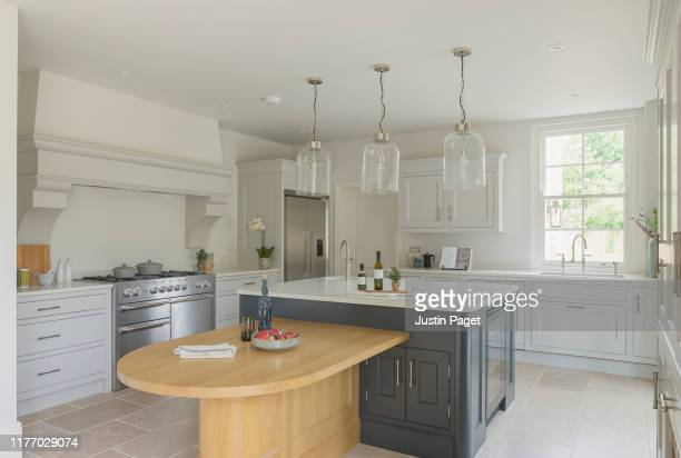 kitchen in new build luxury house - kitchen stock pictures, royalty-free photos & images