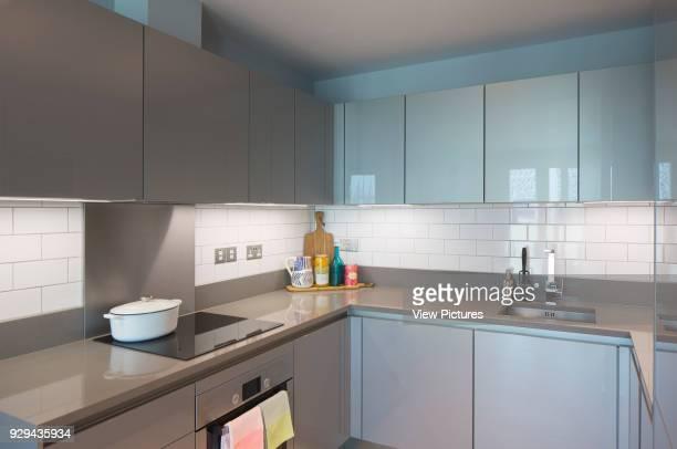 Kitchen in showroom flat. Gateway Pavilions, London, United Kingdom. Architect: Marks Barfield Architects, 2014.