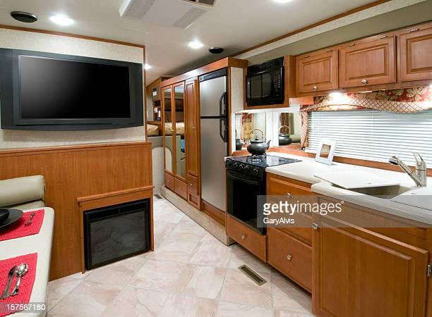 RV kitchen interior photo with cream floor
