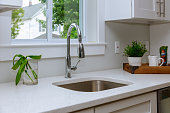 Kitchen Interior with Sink, Cabinets, Stainless Steel in New Luxury Home