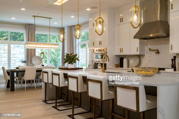 Kitchen Island and Dining area in the Model Townhome at Quarry Springs on August 27, 2020 in Bethesda Maryland.