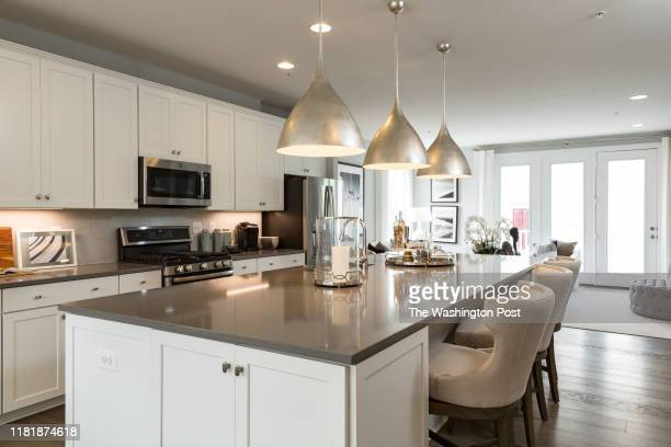 Kitchen Island and Kitchen in the model Townhome at Dream Finders Homes at Glenmont MetroCentre on October 30, 2019 in Silver Spring Maryland.
