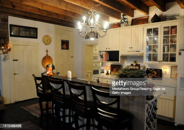 Kitchen island and sitting area with exposed beams.Home of the Innis Family, the former Leinbach's Hotel, in Bern Township for Berks Country Floor...