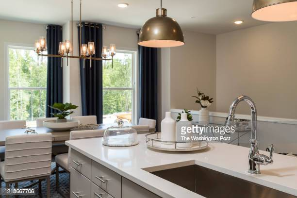 Kitchen Island looking towards Dining area in the Greywood model Townhome at Watershed on June 1, 2020 in Laurel Maryland.