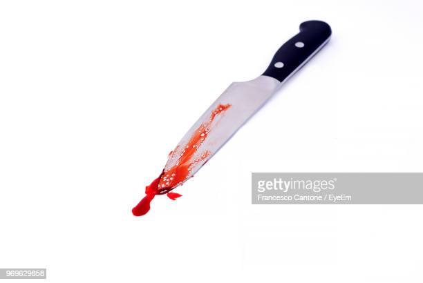 Kitchen Knife With Blood On White Background