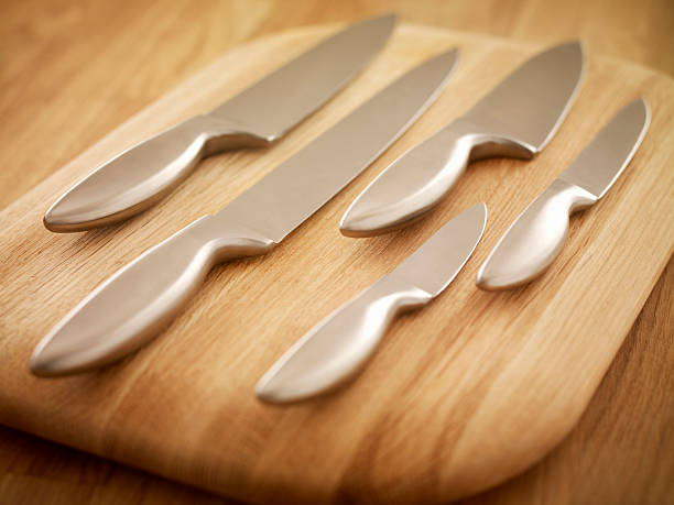Kitchen knives on a wooden chopping board