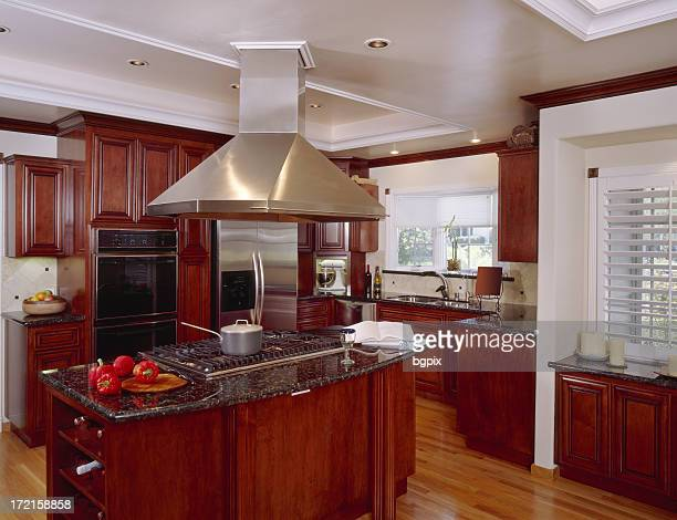 kitchen land with large exhaust hood 2 - granite stock pictures, royalty-free photos & images