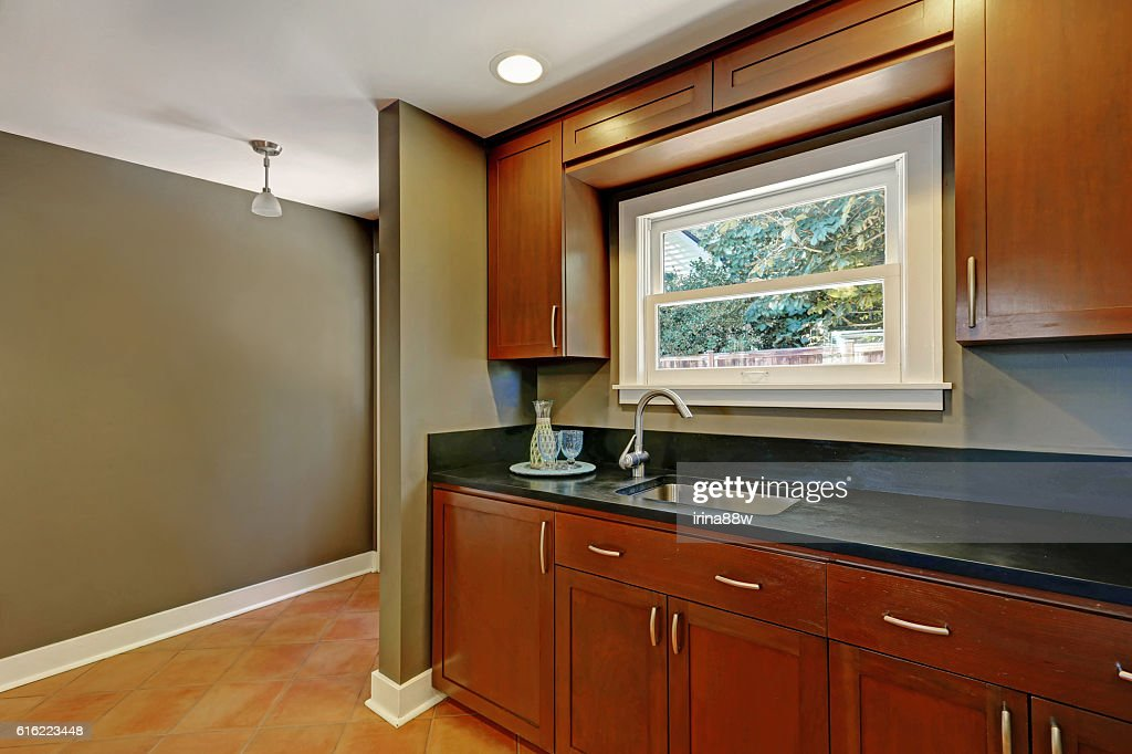 Kitchen mahogany cabinets with a sink. House interior : Stockfoto