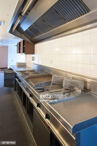 kitchen of a staff restaurant in an office building - afzuigapparaat stockfoto's en -beelden