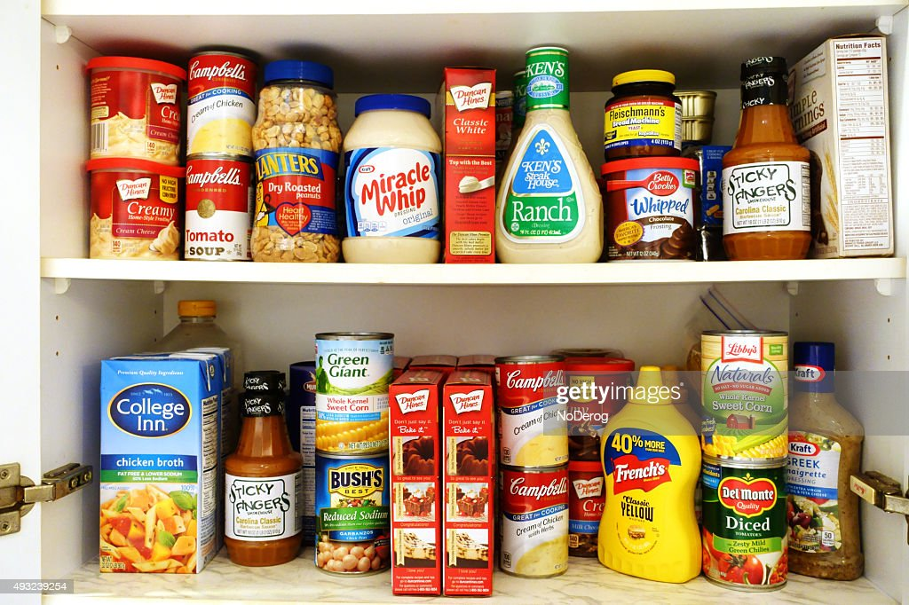 Kitchen pantry shelves filled with groceries : Stock Photo
