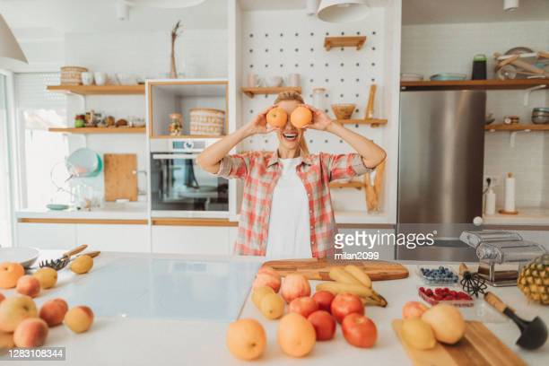 kitchen - mid adult stock pictures, royalty-free photos & images
