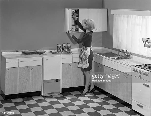 Kitchen scene Warwick Warwickshire 1966 A housewife at work in her new kitchen The kitchen is the new fitted 'American' style with matching formica...