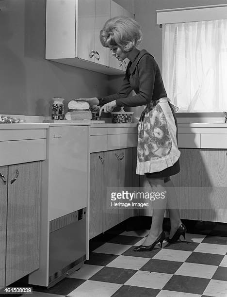 Kitchen scene Warwick Warwickshire 1966 A model is seen at work in the kitchen in this photograph for a press advertisement for a boiler manufacturer...