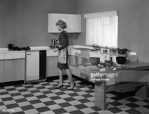 Kitchen scene Warwick Warwickshire 1966 In this advertising image a model is seen in her modern fitted kitchen with built in sink and wrap around...