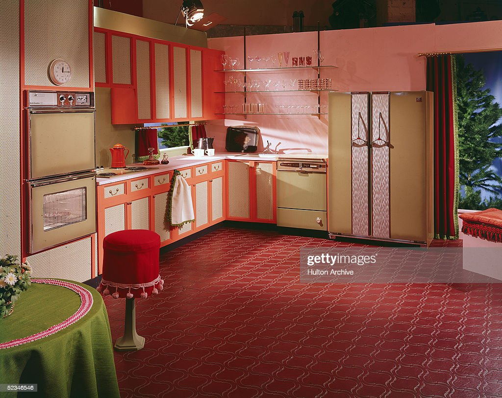A Kitchen Set In A Studio Features Two Kelvinator Ovens A