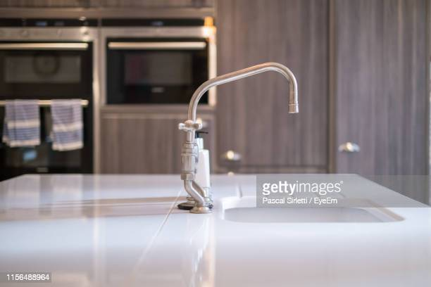 kitchen sink against cabinet at home - kitchen sink stock pictures, royalty-free photos & images