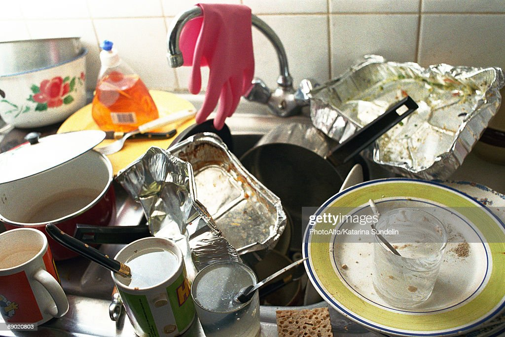Dirty Kitchen Sink Kitchen sink counter piled over with dirty dishes stock photo kitchen sink counter piled over with dirty dishes stock photo workwithnaturefo