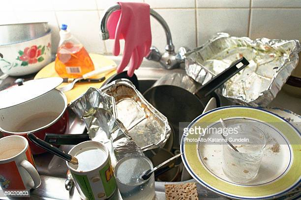 Kitchen sink, counter piled over with dirty dishes