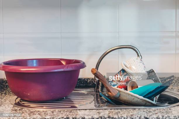 kitchen sink full of dirty dishes - wash bowl stock pictures, royalty-free photos & images