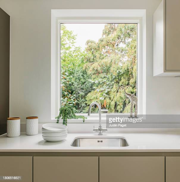 kitchen sink with a nature view - window stock pictures, royalty-free photos & images
