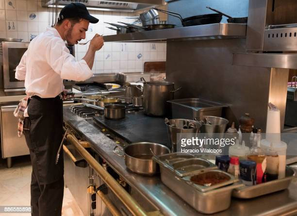 Kitchen staff at work during dinner cooking in Dolce CampoReal Lisboa Hotel for participants of Gastronomic FAM Tour on November 26 2017 in Torres...