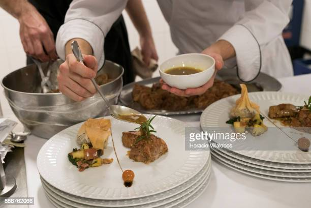 Kitchen staff at work on a dish of goat kid meat in five stars hotel Parador Casa da Insua during Gastronomic FAM Tour on November 28 2017 in Penalva...