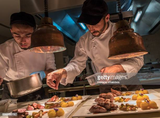 Kitchen staff prepare a dish of Lamb fillets with rebolao potatoes roasted vegetables and mint sauce during dinner cooking in Dolce CampoReal Lisboa...