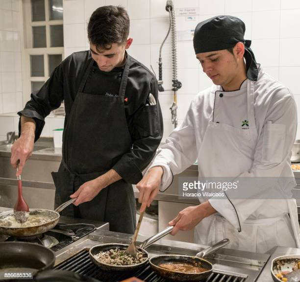 Kitchen staff prepare dinner for participants at five stars hotel Parador Casa da Insua during Gastronomic FAM Tour on November 28 2017 in Penalva do...