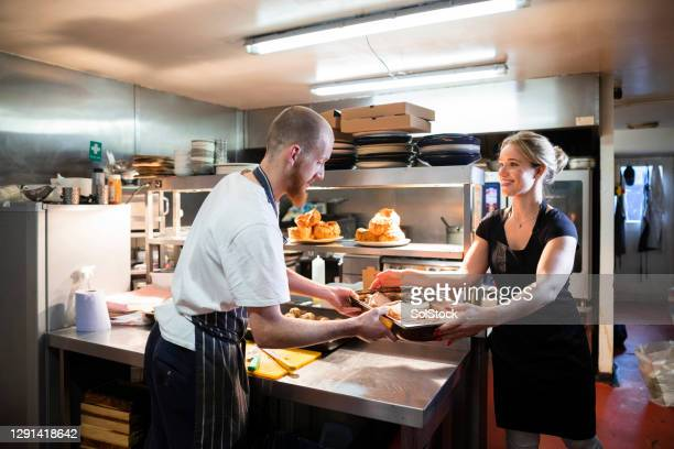 kitchen staff preparing a sunday roast - chef stock pictures, royalty-free photos & images