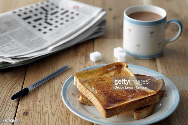 Kitchen table still life with crossword, toast and tea