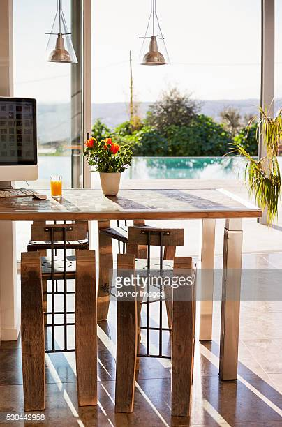 Kitchen table with view at swimming pool