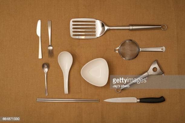 Kitchen tools on brown background