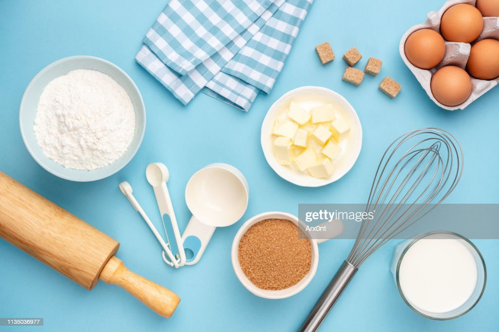 Kitchen utensils and baking ingredients on blue background : Stock Photo
