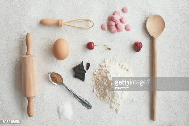 Kitchen utensils and food on white background - knolling