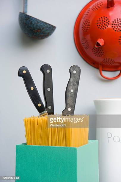 Kitchen utensils, colander, knife block of spaghetti, sieve of enamel, dipper
