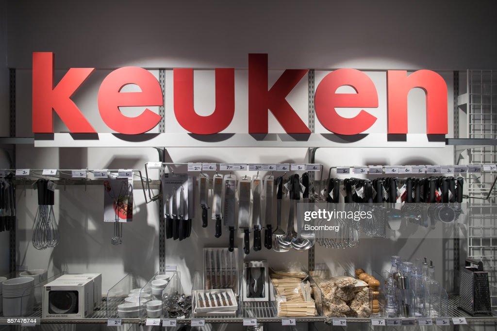 Keuken Outlet Store : Kitchen utensils hang on a homeware display inside a hema bv store