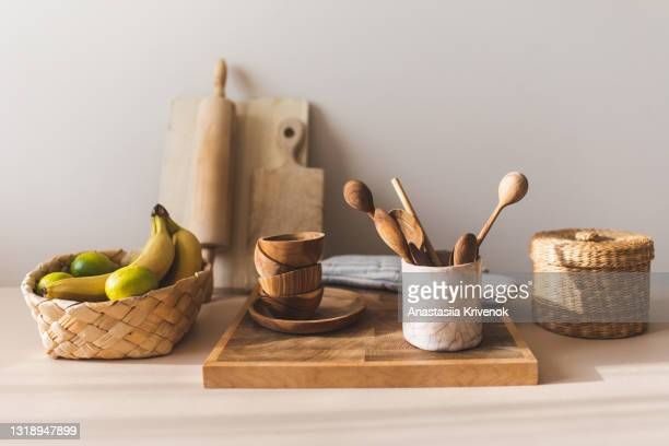 kitchen utensils on home beige background. - measuring spoon stock pictures, royalty-free photos & images